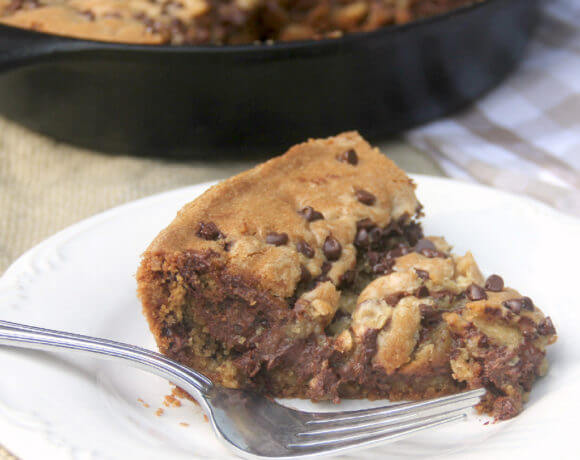 Chocolate Chip Cookie Pie is made with semi-sweet and milk chocolate chips, extra brown sugar and butter--and more chocolate sprinkled on top!