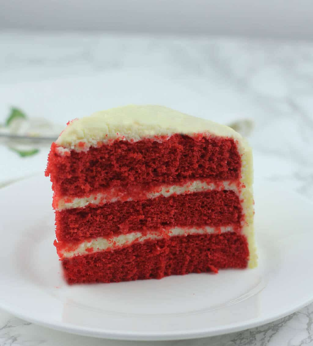Southern Red Velvet Cake with Cream Cheese Frosting comes from an easy and moist red velvet cake recipe that will quickly become a family favorite!