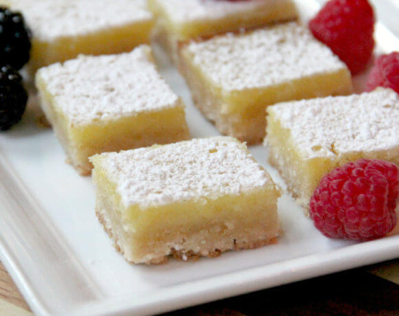 Easy lemon bars with a zesty lemon custard atop a crisp brown sugar shortbread crust--these lemon bars lovely and delicious!