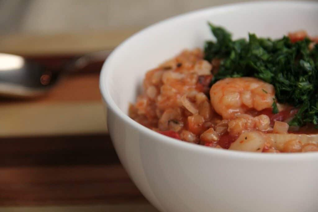 bowl of shrimp, farro, and tomato risotto