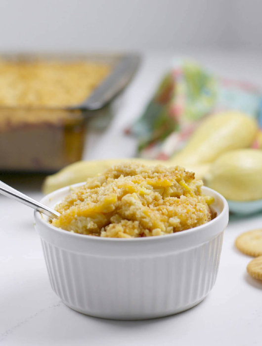 Southern squash casserole is a staple at any potluck gathering. With grated Cheddar cheese, crumbled Ritz crackers, and fresh summer squash, this squash casserole is a family favorite!