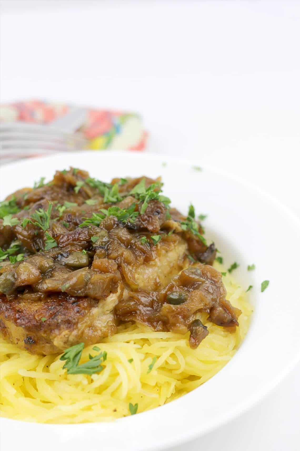Pork chops with caramelized onions, capers, and white wine are delicious with noodles, mashed potatoes, cheese grits, or spaghetti squash.