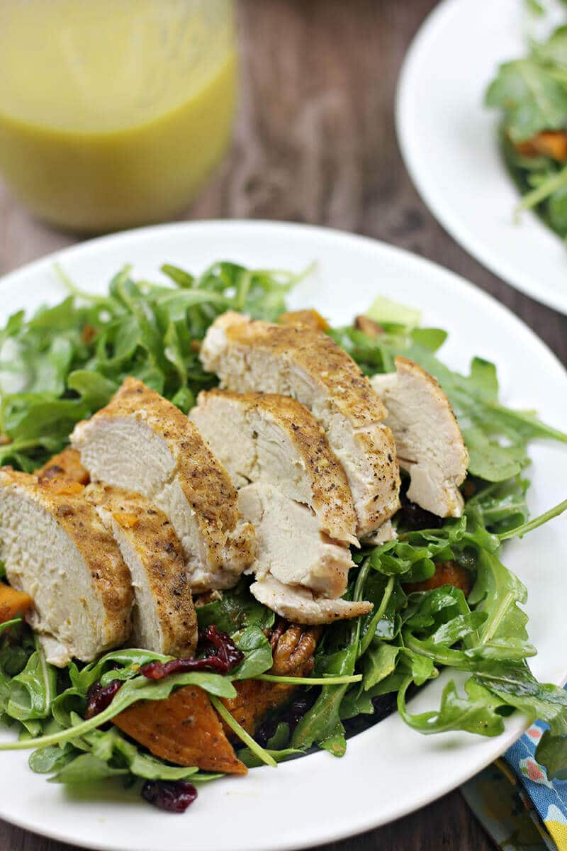Arugula Salad with Roasted Sweet Potatoes and Chicken in salad bowl.