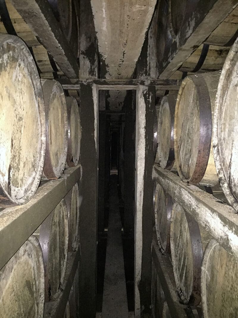 Kentucky Travel Guide showing Rows of bourbon barrels at Buffalo Trace distillery.